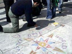 An activist draws a compass rose